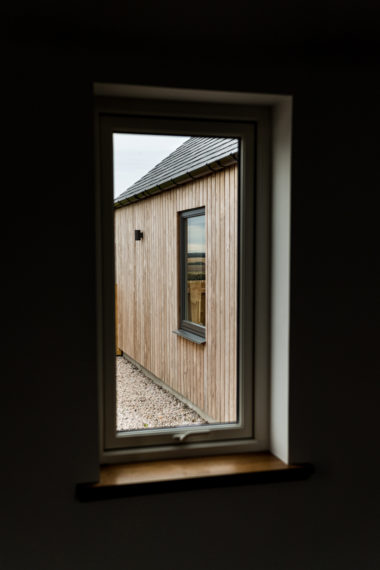 Timber Cladding with Grey Window