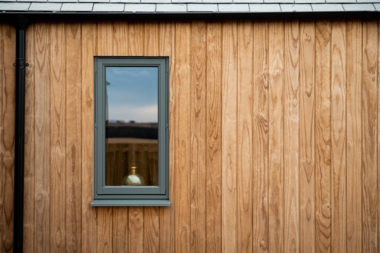 Grey Window Against Timber Cladding