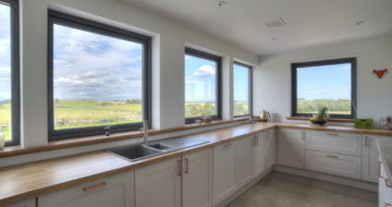 Self build home millbank of udny station internal kitchen utility room multiple grey windows